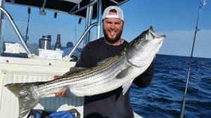 Dave Bittle Jr. of Florida displays one of the many striped bass he landed on Board Relentless Charters on Monday June 20th, 2016