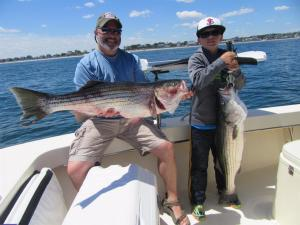 Ed and Zac Buccigross spending quality time together fishing on Relentless Charters.