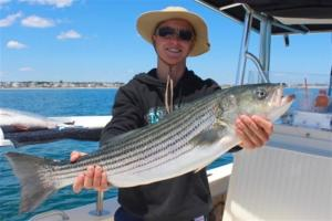 Jared Evers from California gets a taste of striped bass fishing on  board RELENTLESS