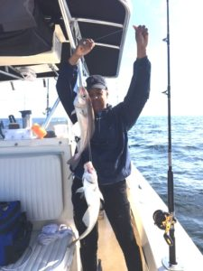 Donna shows the boys how to catch two haddock at a time