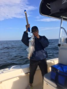 Donna displays a nice large haddock she landed aboard RELENTLESS CHARTERS fishing on Stellwagen Bank